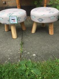 Pair of padded wooden footstools