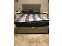 Grey double divan bed with two draws and head board