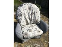 Large grey cane armchair