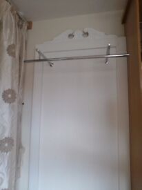 Clothing rail with glass shelf and ornate white board backdrop panel (x2)