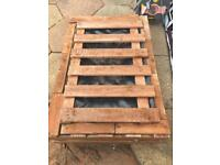 Homemade wooden sand pit or pond