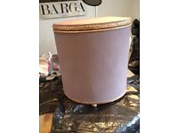 small painted rose wicker basket suitable for a bedroom or bathroom