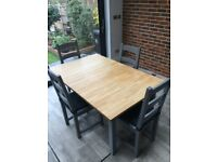 Solid wood extending dinning table and four chairs