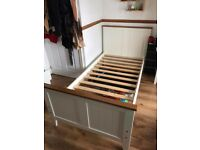 White wooden single bed with memory foam mattress