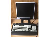 Computer monitor with mouse and keyboard