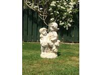 Brother and sister garden ornament