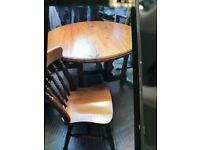 Solid pine convertable table and 3 new chairs in excellent condition for quick sale