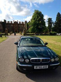 jaguar xj6 in British racing green