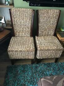 Two solid wood rattan chairs