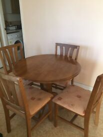 Dining table and 4 chairs. Good condition. Ideal for small area
