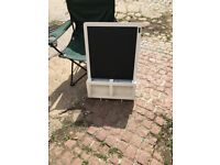 A vintage chalkboard with original chalk compartments