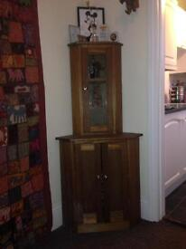 Hand made solid wood corner cabinet. Glass display top.