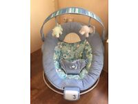 Vibrating Baby Bouncer with Music. Bright starts. 2 reclining positions. Suitable from birth.