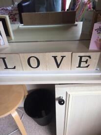 Love scrabble letters on stand