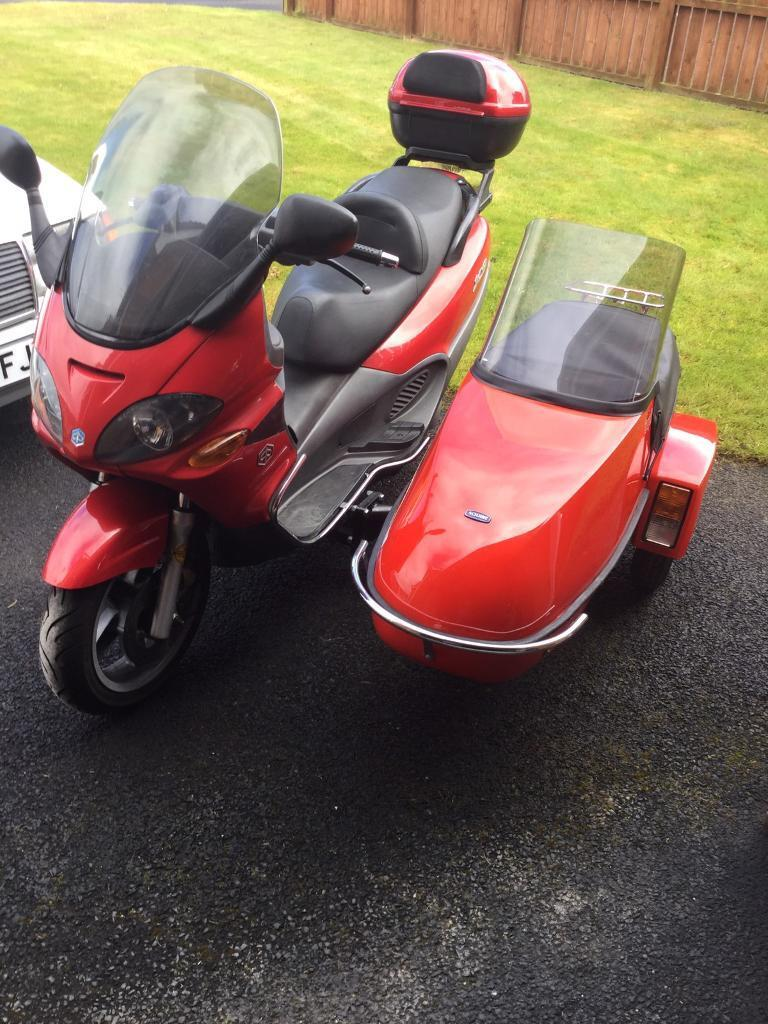 Piaggio x9 250 sidecar outfit may split.