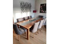 Extendable dining table, solid oak, seats up to eight