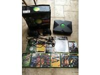 Boxed original Xbox with leads, manuals and 7 games