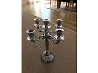 10 silver coloured metal candelabras and cyrstal neckless decorations