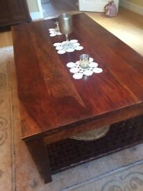 Solid Dark wood coffee table. Large with leather lower shelf