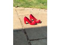Red patent shoes