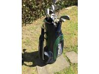 Golf bag and various clubs