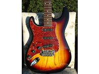 Left-handed G&L Legacy Tribute hardtail string-through-body.