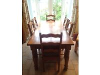 Solid oak dining table and 6 chairs for sale.