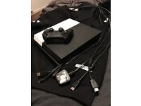 PlayStation 4 with games and cables