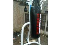Here I have for sale a weight bench with the chest bar + free standing punch bag and speedball set