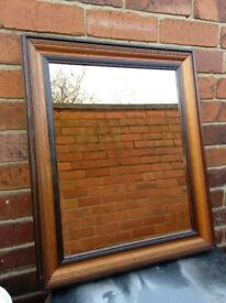 2x wooden framed mirrors