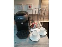 Bosch Tassimo Vivy coffee machine with coffee pods and pod holder, descaler tablets, cups & saucers
