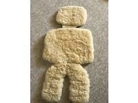 Natural sheepskin buggy/car seat liner for comfort, warmth and temperature regulation