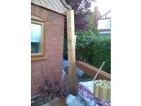 Wooden garden gate post