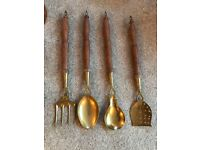 Brass spoon collection with wooden handles
