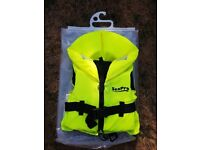 3 Sea pro childrens life jackets EN395-100N, high viz yellow with reflectors and whistles.