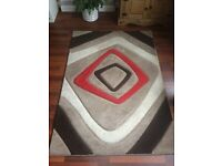 beige and red rug