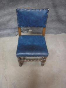 Chair, hardwood, straight back, blue leather upholstery and button studding