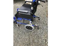 Enigma adult wheelchair in very good condition has breaks on handlebars removable footrests