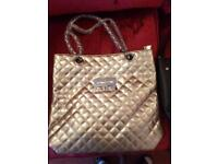 Brand new gold 14 inch bag