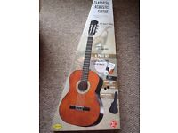 Brand new boxed classical acoustic guitar with case, electronic tuner, 2 x picks, book & CD