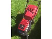 Rotary petrol lawnmower
