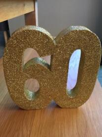 Gold 60th Birthday decorations - ten in total.