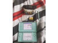 Nintendo DS Lite console and guitar hero game