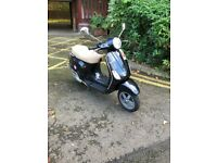 Vespa LX 125 less than 2900 miles!