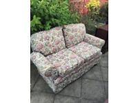 Floral two seater sofa can deliver