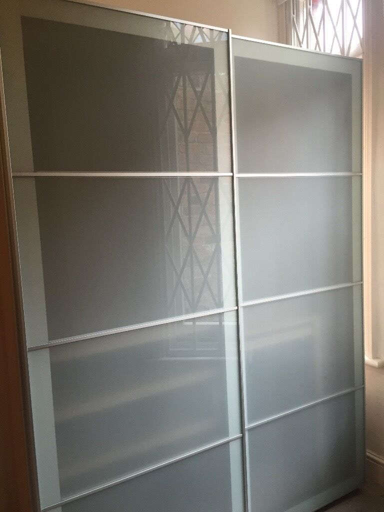 Ikea pax wardrobe white stained oak effect frosted glass for Ikea glass sliding doors