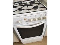 Cooker, double bed, table and chairs