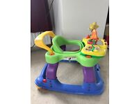 Colourful baby walker with a selection of toys