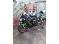 For sale kawasaki zx1000 being used as a track bike ,but can be put back to being used on the road.