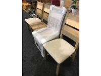 Four new wooden chairs